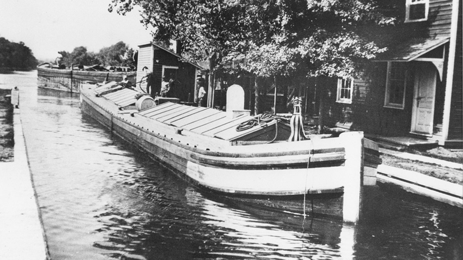 Here a hinge canal boat sits tied up to the banks in Freemansburg.