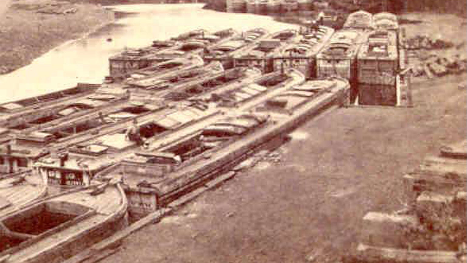 It took a while to fill a canal boat with coal.  These boats wait for their turn to get loaded up.  Captains and mule tenders could get off of their boats until it was time to move them along.