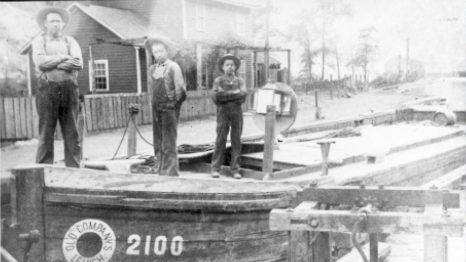 This is a great picture of a captain and his two sons who work with him to operate his canal boat.