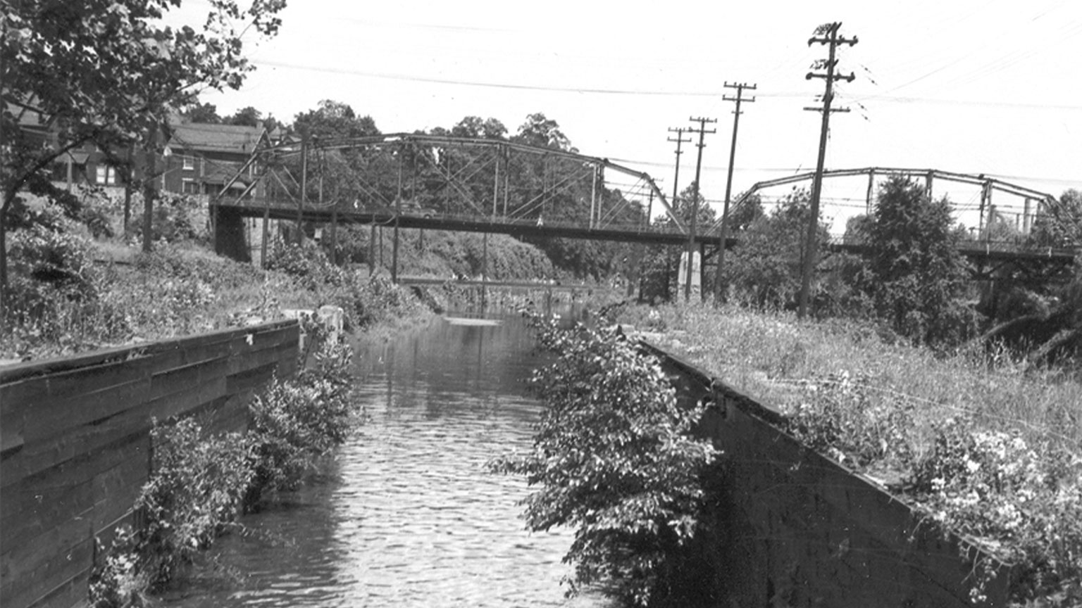 This picture does a nice job of showing what the walls of the locks looked like.  However, this picture was taken after the canal was no longer used which is why plants are starting to take back over.