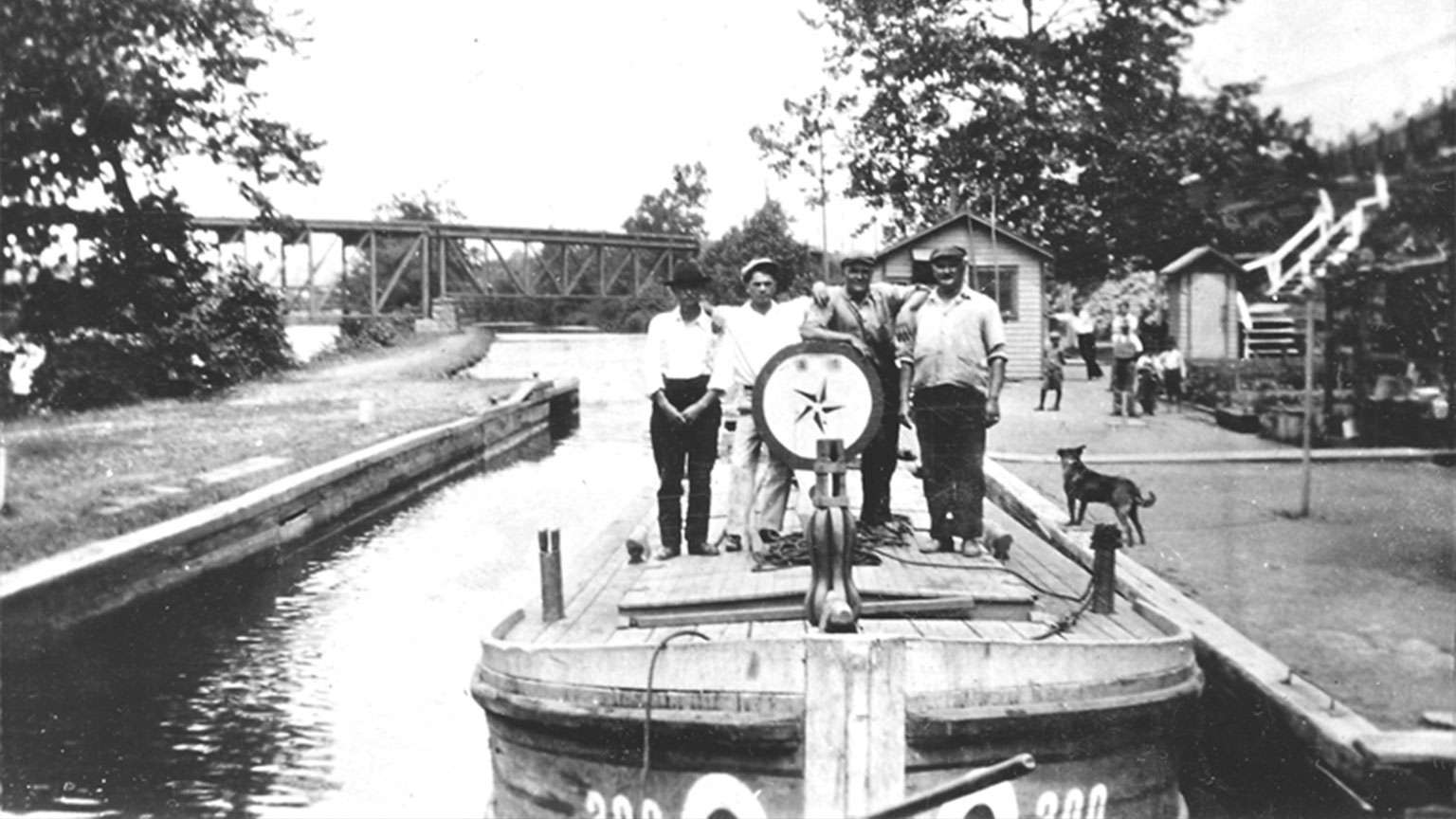 This picture really shows the life that went on at the locks along the canal.  It also highlights a nicely painted dasher for a nighthawker that the men posed around for a photo.