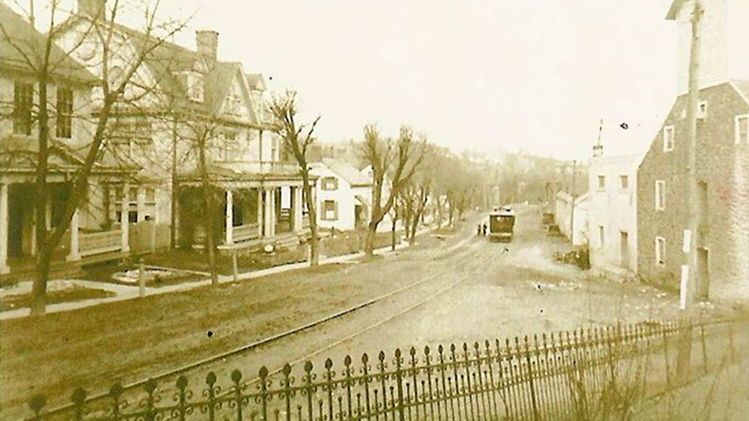 The main road was wide, but muddy. The road was lined with houses and had a trolley that ran down the middle.