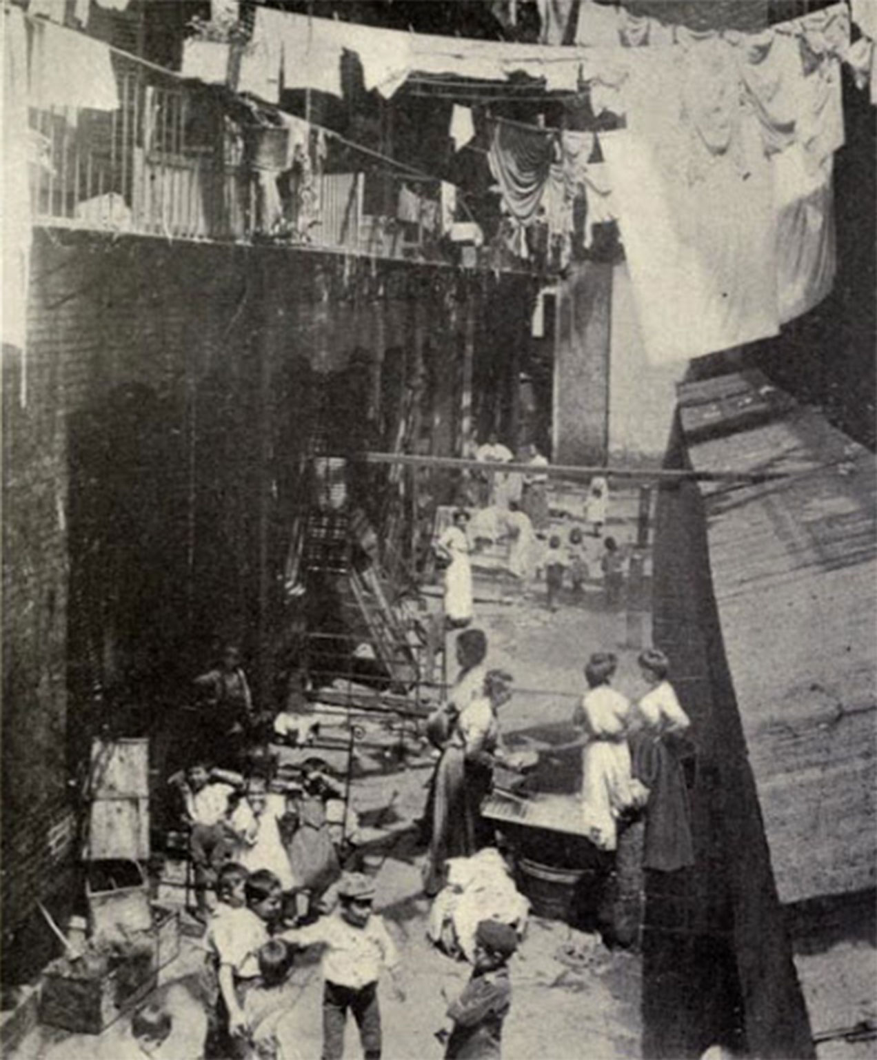 These little spaces of outside were busy with all of the people who lived in the tenements. Children played, women did wash, gardens grew, garbage was thrown.