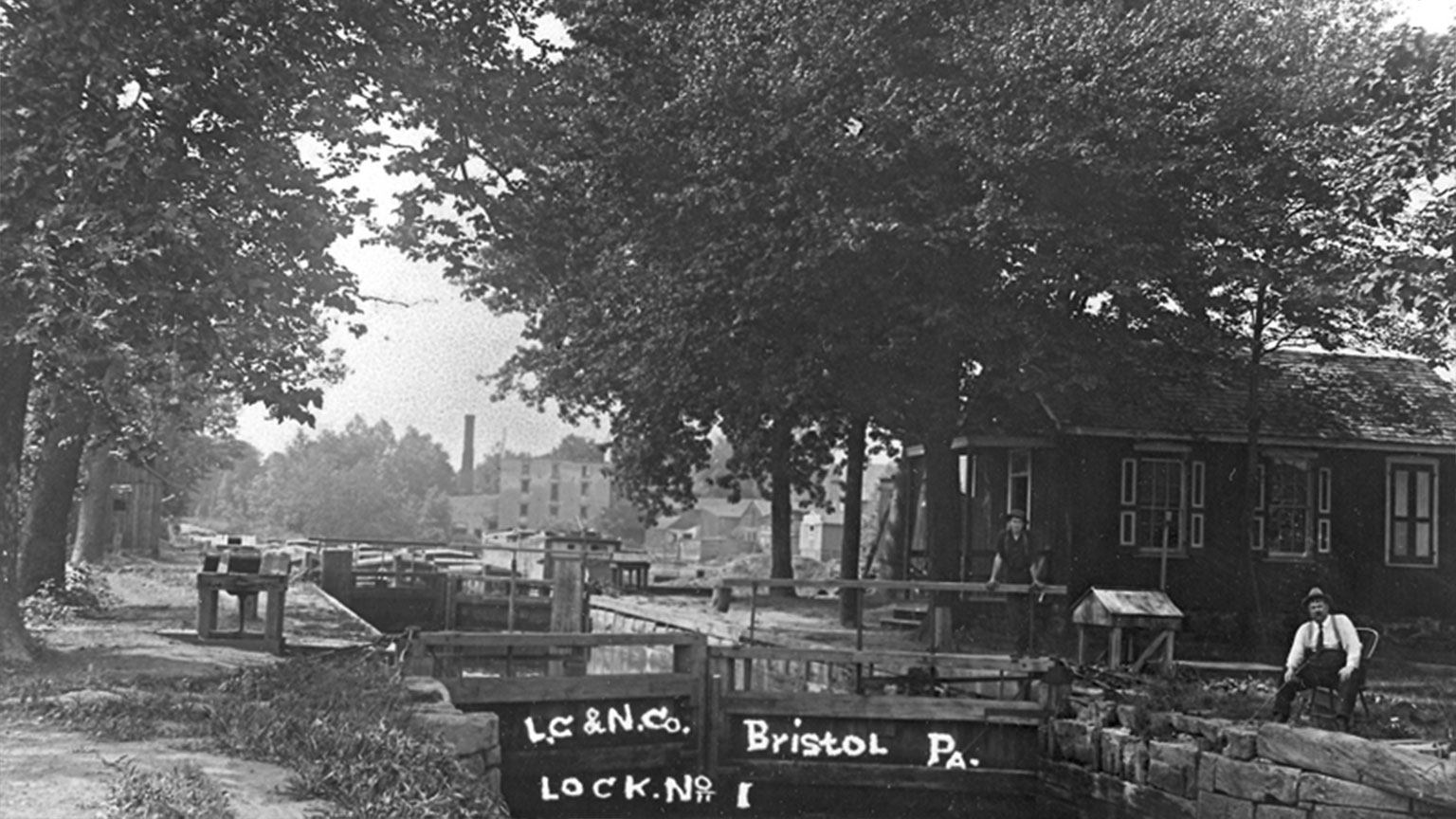 The toll collector's job was to collect toll money from anyone using the canal that was not using a LCNC boat.  He was able to tell that because only the LCNC boats had the white circles on the front.