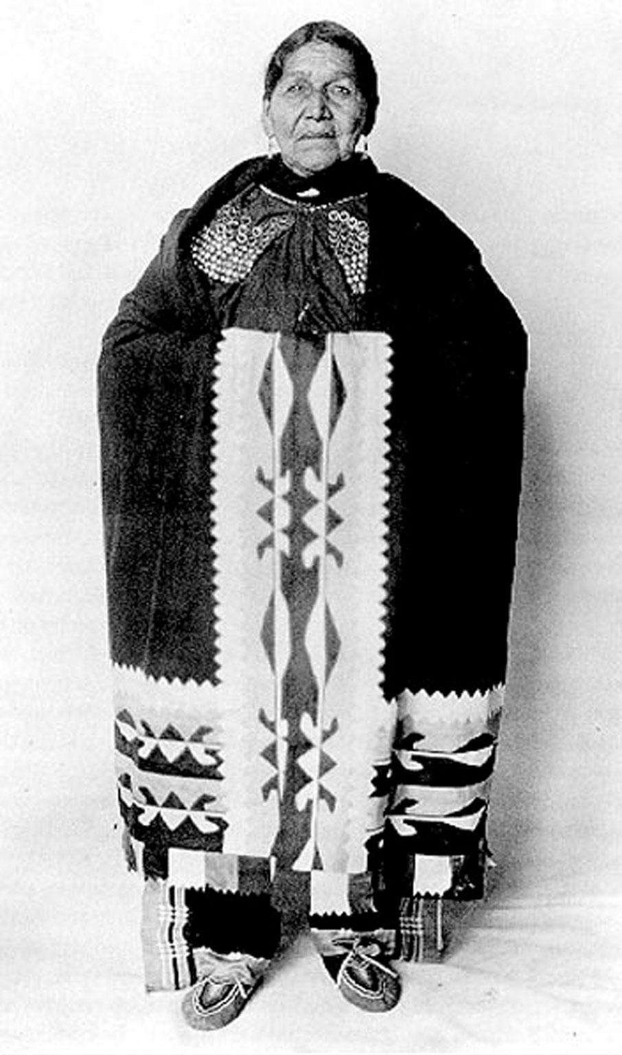 Susie Elkhair wearing ribbonwork shawl.